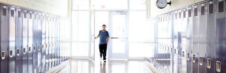 Header image of student in a hallway