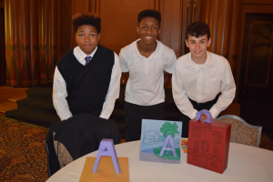 Akron students pose with their prototypes for promoting art