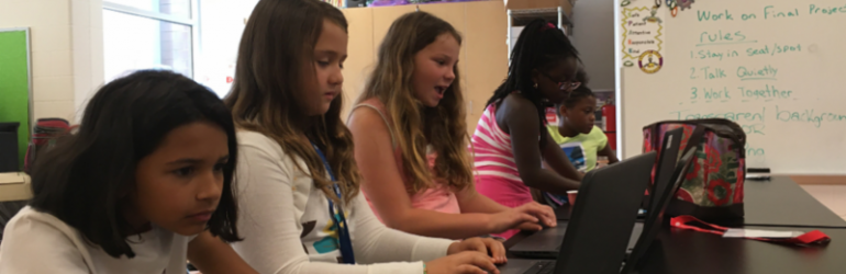 Header image of girls working at the Reynoldsburg Techie camp