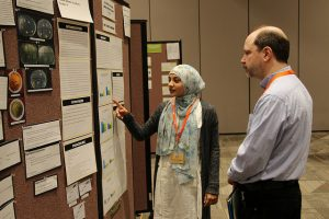 Image from 2016 Ohio JSHS of a student presenting her research