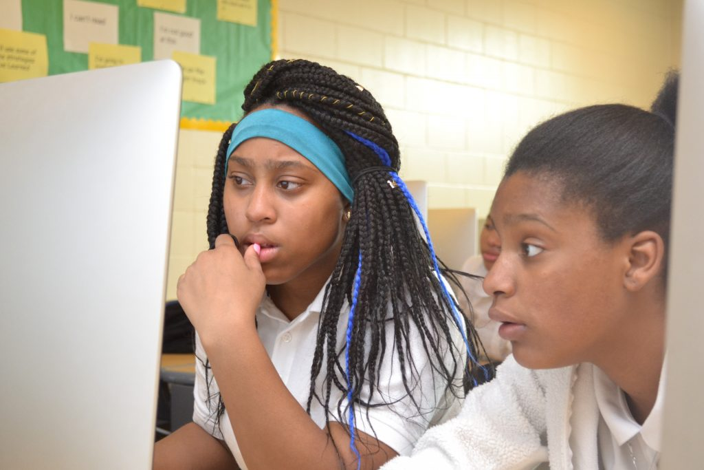 Jahnasia Robinson and Kenaysha Minter collaborate using the CODE.org Game Lab