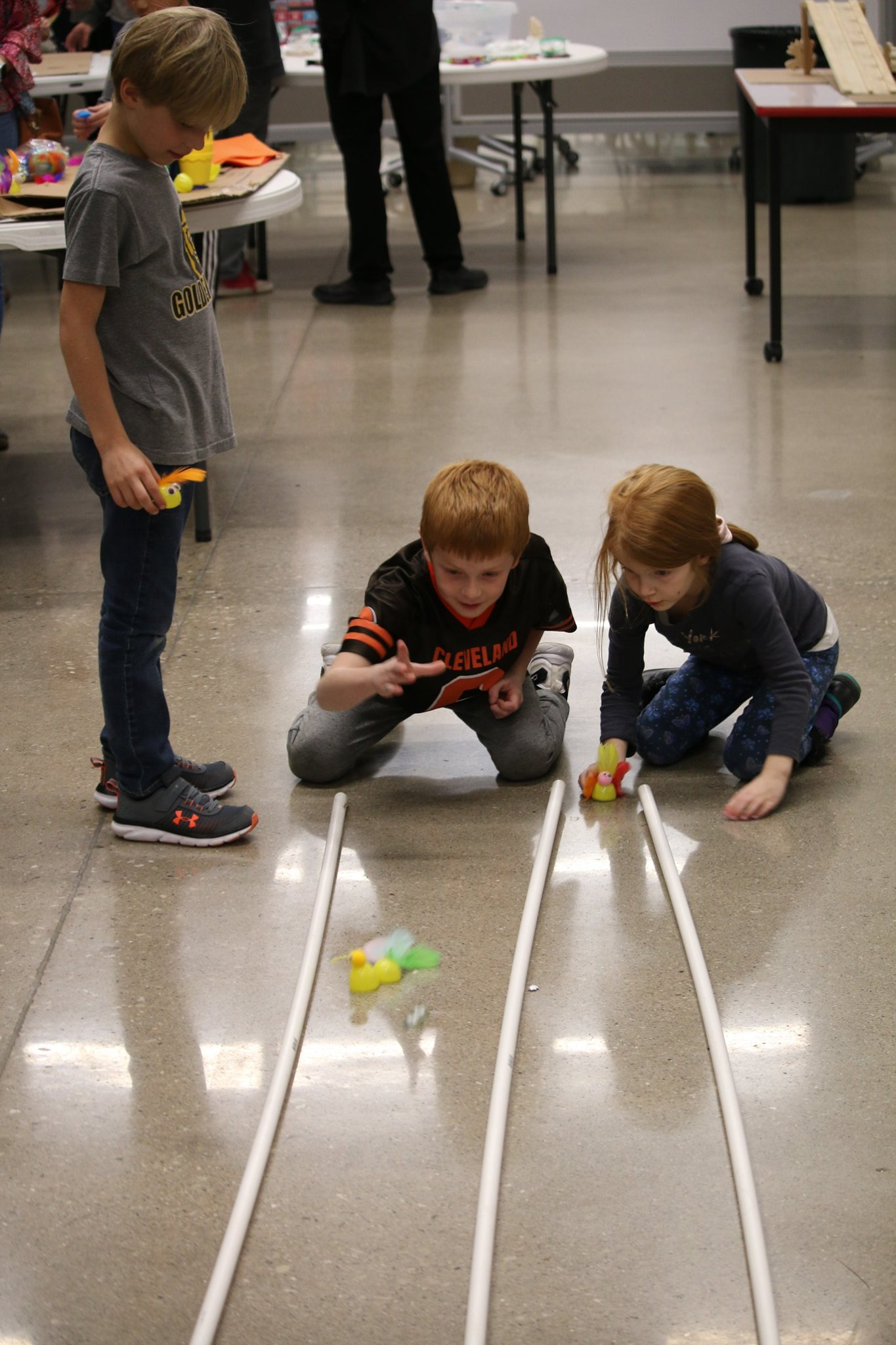 students racing cars at past foundation
